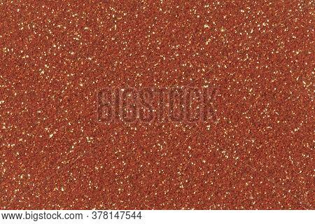Orange Glitter Texture Christmas Background. Low Contrast Photo.