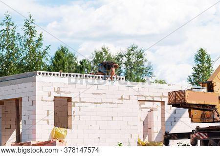 Builder Worker Installing Concrete Floor Slab Panel At Building Construction Site