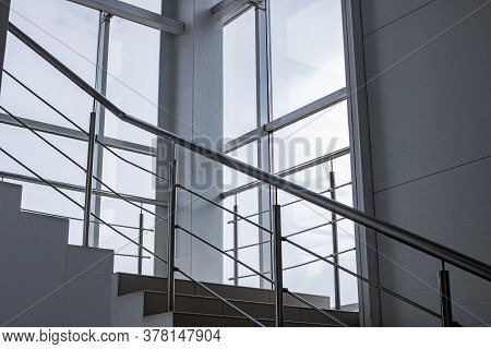 Staircase With Metal Railings By The Window