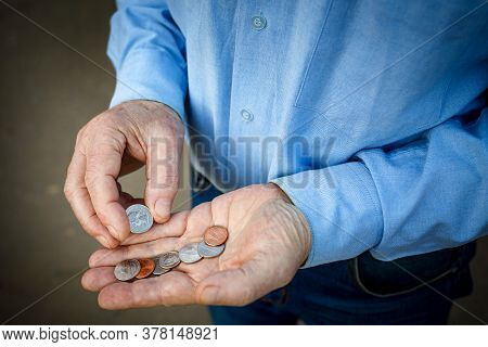 Hands Of A Senior Citizen With Cents, Senior Man Counts His Money. The Concept Of Poverty, Small Pen