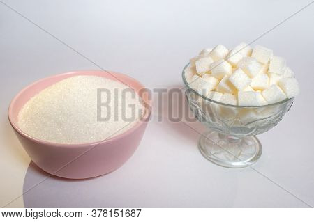 Two Types Of Sugar, Crumbly And Cubes, White Sugar On A White Background, Flavoring Food Supplement