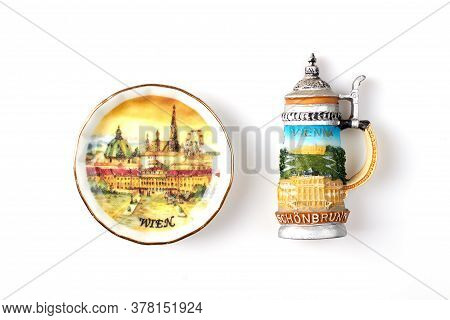 Souvenir Dish Mug And Plate Isolated On White Background. Decorative Vienna Souvenirs With Cityscape