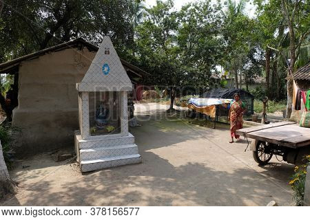 MITRAPUR, INDIA - FEBRUARY 26, 2020: Shrine in the backyard of a farmhouse in Mitrapur, West Bengal, India