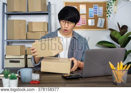 Asian Business Man Startup Sme Entrepreneur Or Freelance Working In A Cardboard Box Prepares Deliver