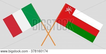 Crossed Flags Of Oman And Italy. Official Colors. Correct Proportion. Vector Illustration