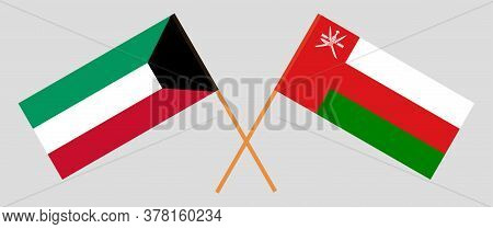 Crossed Flags Of Oman And Kuwait. Official Colors. Correct Proportion. Vector Illustration
