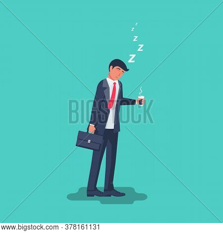 Sleepy Businessman In A Suit With A Briefcase Stands With A Cup Of Coffee. Dose Of Energy On Monday