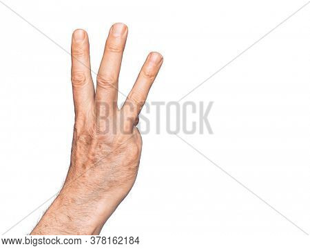 Hand of caucasian middle age man over isolated white background counting number 3 showing three fingers