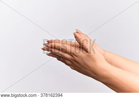 Hand of caucasian young woman touching palms praying with both hands together, catholic religious symbol