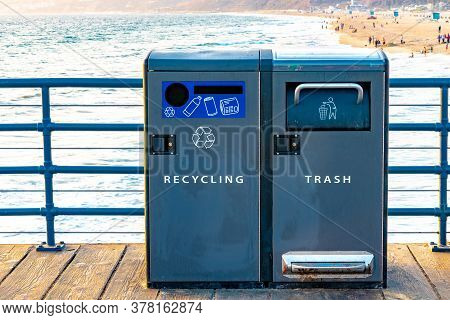 Recycling And Trash Bins At Beach. Public Garbage Disposal Cans Labeled And With Icon Symbols.