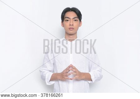 Young handsome man with wearing casual t-shirt standing touching fingertips of both hands,