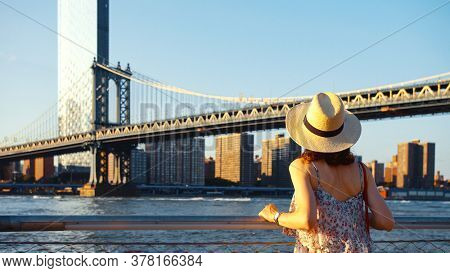 Young woman on the view point at sunset, NYC