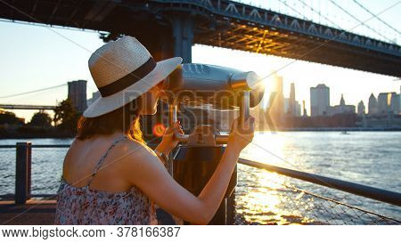 Young tourist on the view point at sunset, NYC