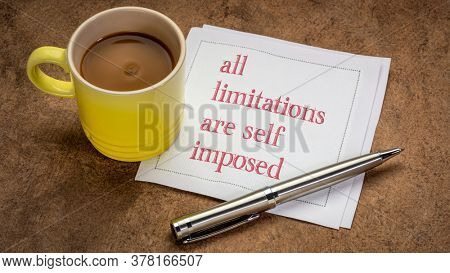 all limitations are self imposed inspirational note - writing on a napkin with a cup of coffee, business or personal development concept