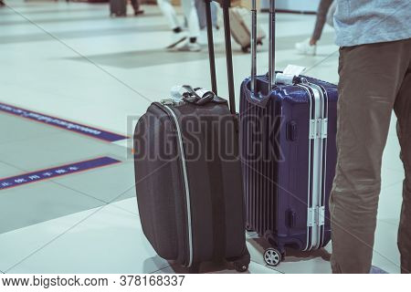 Traveler Tourists With Luggage, Baggage Reclaimed Cancel Flights Stop, Prevent Covid-19 Virus Diseas
