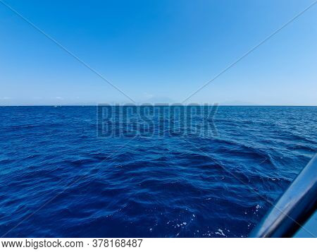 View Of The Deep Blue Sky And Deep Blue Sea From A Ship In Bali, Indonesia During Summer.