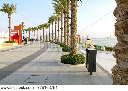 Dubai / Uae - June 19, 2020: Dubai Creek Harbour Promenade/walk With Beautiful Green Palms During Su