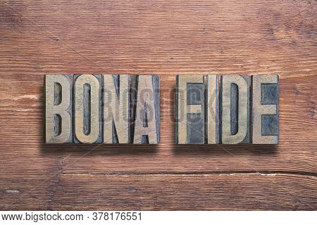 Bona Fide Ancient Latin Saying Meaning - Good Faith, Combined On Vintage Varnished Wooden Surface