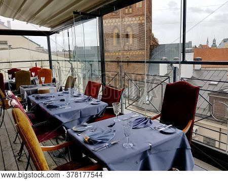 Latvia, Riga, July, 2020 - Cozy Interior Of The Gutenberg Restaurant Overlooking The Rooftops Of The