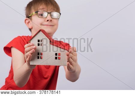 Happy Boy Shows Model Home. Real Estate, Family Home, Foster Home Care.