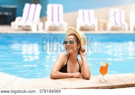Sexy Millennial Lady In Black Swimsuit And Sunglasses Relaxing By Poolside At Tropical Resort, Blank
