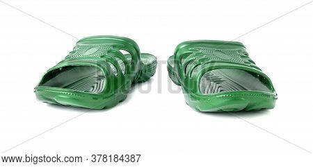 Pair Of Cheap Durable Green Rubber Slippers Isolated On White Background.