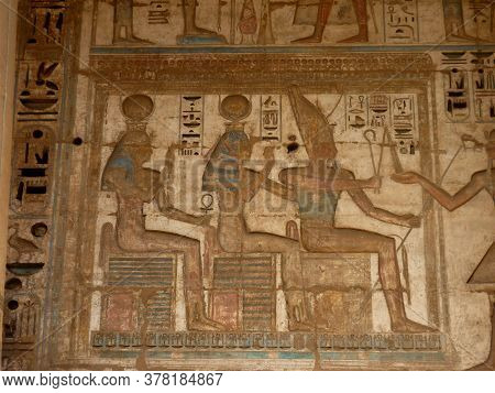 Pharaonic Rare Colored Sculptures & Hieroglyphs On A Wall At A Temple In Luxor, Egypt
