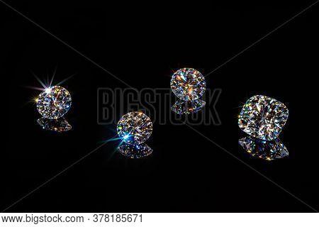 Diamonds Brilliance. Shining Gemstones On Black Background
