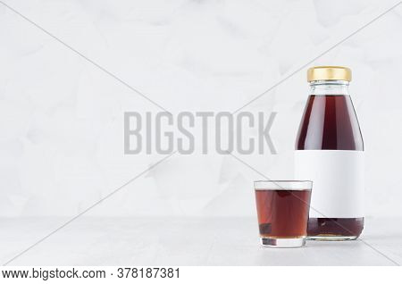 Fresh Red Transperent Cherry Juice In Glass Bottle Mock Up With Blank Label,  Wine Glass On White Wo