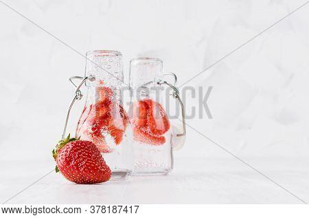 Summer Homemade Drinks - Infused Strawberry Water With Sliced Berry, Soda In Yoke Bottles In Soft Li