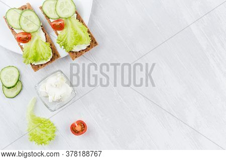 Fresh Spring Vitamine Sandwiches Of Flat Cereal Rye Dry Crisps Bread With Green Lettuce, Cucumber, T
