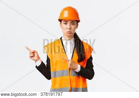 Building, Construction And Industrial Concept. Upset Sulking Female Engineer In Reflective Clothing