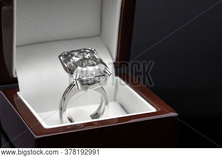 Engagement Jewelry Ring With Emerald Cut Diamond In Jewelry Box