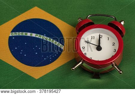 Brazil Flag And Vintage Alarm Clock Close Up. Time To Travel To Brazil.