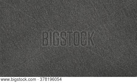 The Fabric Texture Is Fluted Grey.the Background Of Dense Dark-gray Patterned Fabric.