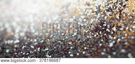 Soft focus gold and black glitter shine dots confetti. Abstract light blur blink sparkle backgound.