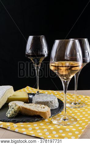 French Cheese And Wine. Rosé And Bourgogne In Glasses. Cheese Board And Yellow Napkin