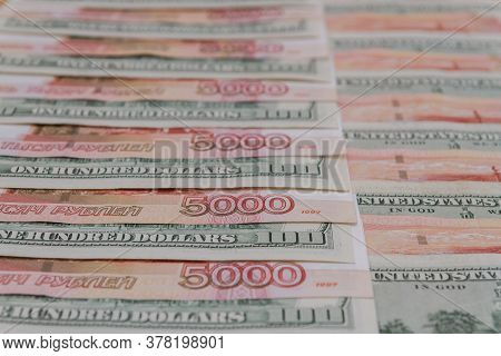 A Large Number Of American Hundred Dollar Bills And Russian Five Thousand Dollar Bills