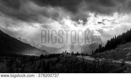 Black And White Photo Of Bad Weather Over Highway 1 Near The Town Of Banff In Banff National Park, A