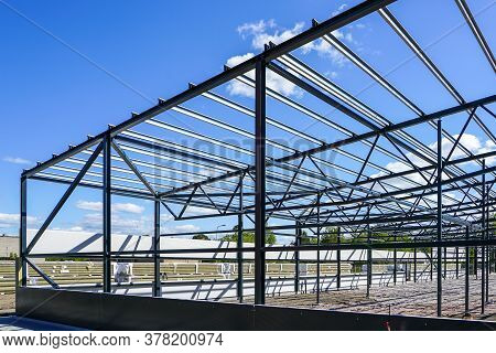 Construction Of A New Modern Industrial Building, Metal Truss Frame