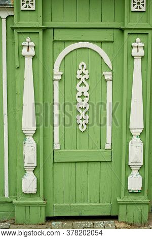 Old Wooden Doors Decorated With Figurines Carved From Wood. An Old Russian House. Historic Center.