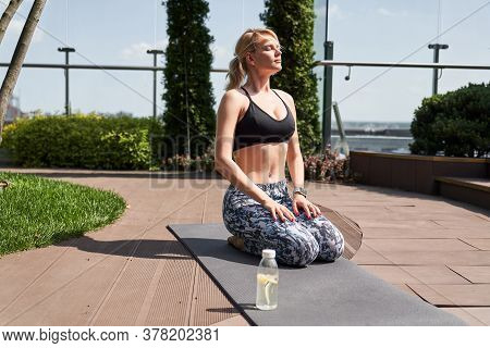Calm Lady On The Sports Ground Relaxing Alone