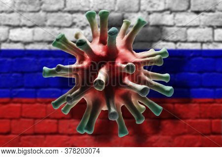 Coronavirus Cell On The Brick Wall Painted In Russian Flag Colors Background
