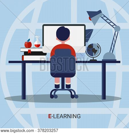 E-learning. School Boy Learning At Computer Doing Homework Online Sitting At Desk Over Blue Backgrou