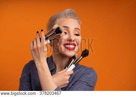 Close Up Portrait Makeup Artist. Make Up Courses. Concept Of Self Visage Masterclasess. Woman Hold M