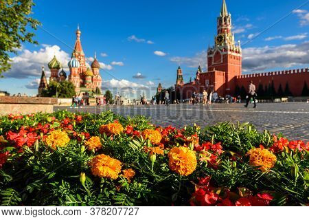 Moscow Kremlin And St Basil`s Cathedral On Red Square, Russia. This Place Is Famous Tourist Attracti