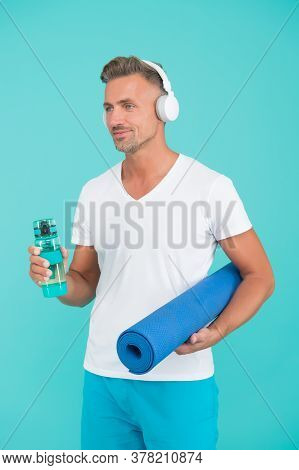 Muscular Man Exercising At Home With Sport Mat, Daily Workout Concept.