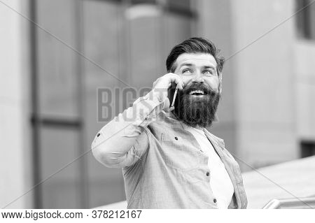 Handsome Man With Bristle Outdoors. Man Wearing Casual Shirt Hold Smartphone. Modern Life. Agile Bus