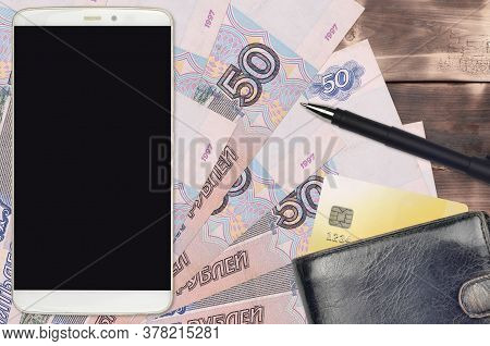 50 Russian Rubles Bills And Smartphone With Purse And Credit Card. E-payments Or E-commerce Concept.