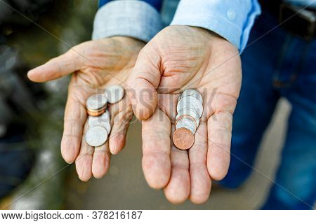 American Cents In The Hands Of An Elderly Man And Woman. Open Palms, Coins Arranged In A Row.
